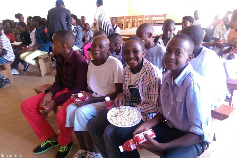 Children sharing goodies during a holiday party. Sharing is a sign of love and builds good friendships.  / Dennis Agaba.