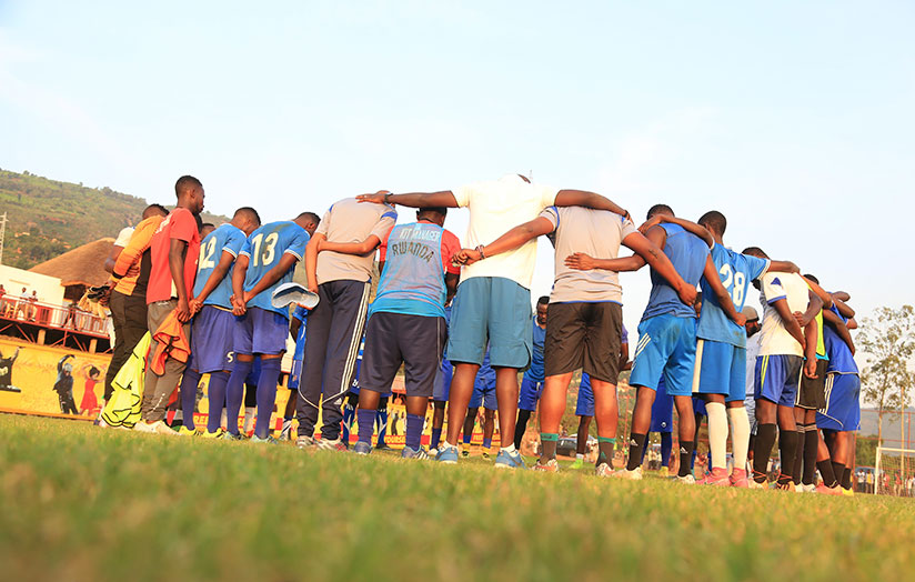 1513024696Rayon-players-and-coaching-staff-join-hands-in-prayer