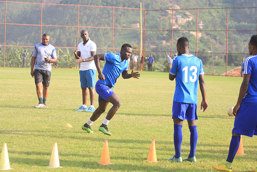 1513024443Karekezi-puts-forward-Tidiane-Kone-through-his-paces-during-the-training-session-at-Nzove-ground-yesterday.-Sam-Ngendahimana