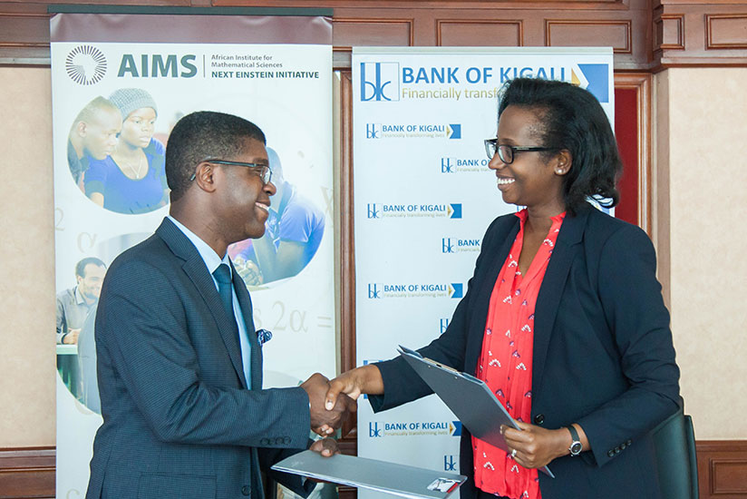 Chief Executive of BK Dr.Diane Karusisi exchanges the document with the president and CEO of AIMS Thierry Zomahoun, yesterday after signing the memorandum of understanding between ....