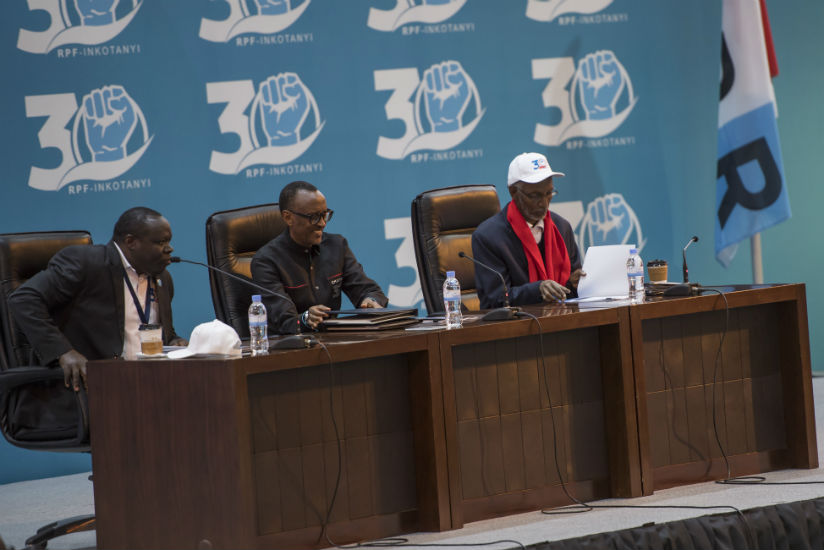President Kagame was yesterday overwhelmingly reelected as chairman of the  Rwanda Patriotic Front for a five year-term. Christophe Bazivamo (L) and Francois Ngarambe (R) were also....