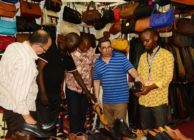 Customers check out shoes at the expo attracted hundreds of showgoers. The trade fair, which opened on Friday, will end on December 31. / All photos: Frederic Byumvuhore