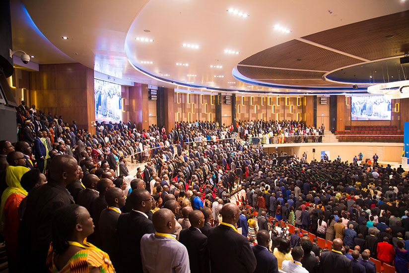 1513589912Delegates-attending-the-National-Dialogue-Council-(Umushyikirano)-observe-the-national-anthem-at-Kigali-Convention-Centre-early-Monday.-Timothy-Kisambira