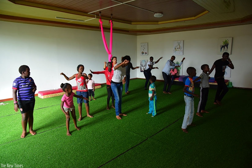 Children practice the traditional dance