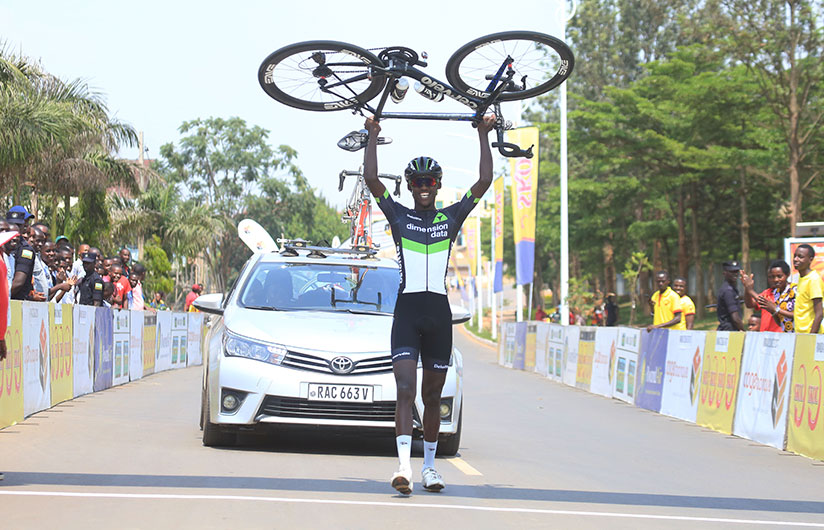 1514656847Dimension-Data-rider-Samuel-Mugisha-lifts-up-his-bike-to-celebrate-the-solo-finish-of-the-108