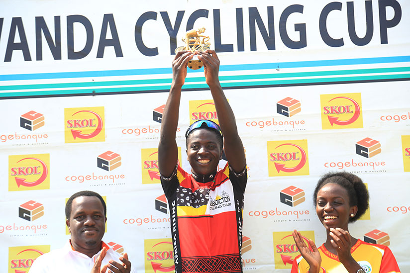 1514657434The-overall-winner-of-Rwanda-Cycling-cup-in-U-23-category-Didier-Munyaneza-lifts-his-trophy-yesterday