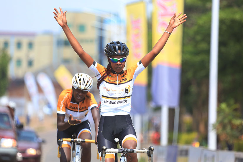 1514657201Les-Amis-Sportifs-rider-Beatha-Ingabire-celebtrates-her-victory-as-she-crosses-the-finish-line-(Sam-Ngendahimana)