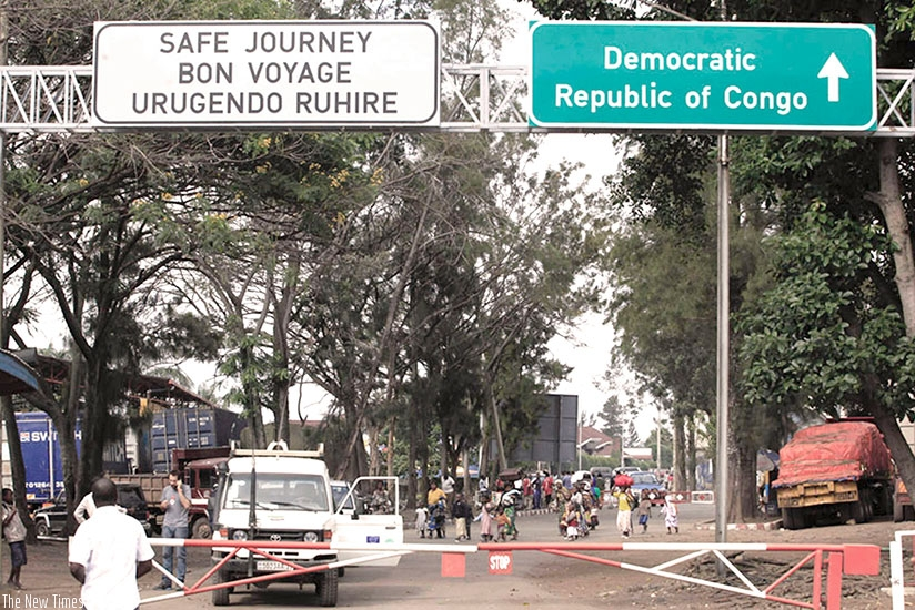 Cross-border traders at the Rwanda-DR Congo border in Rubavu District. Small-scale traders complain of illegal taxes levied by DR Congo authorities contrary to commitments from bot....