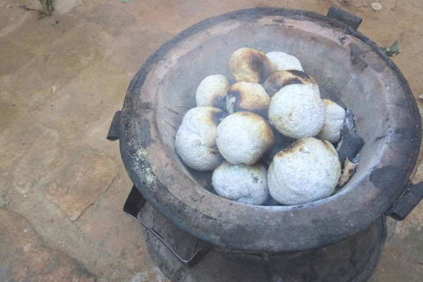 Paper charcoal being used to cook on a stove.