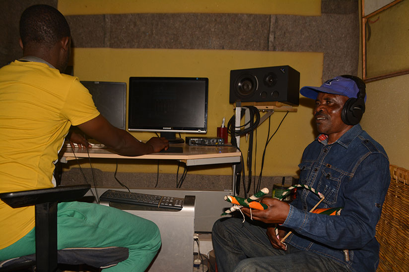 1517079476Namukunzi-alongside-his-producer-who-owns-Level-9-record-Music-Studio-in-Gisozi-during-the-rehearsals