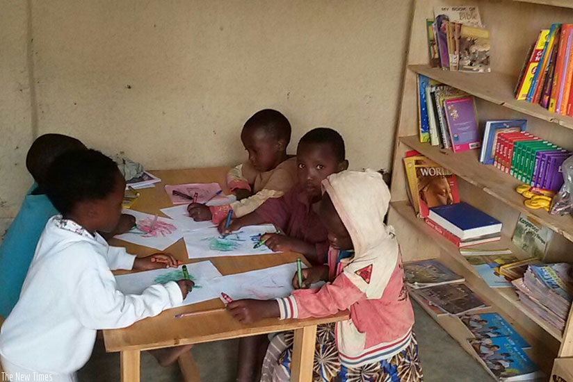 Children engage in a painting activity in a library. (Dennis Agaba)