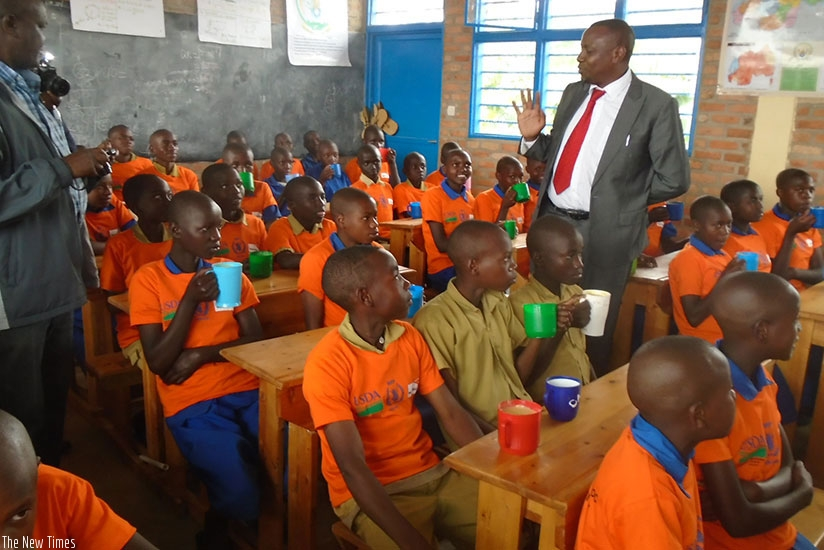 Pupils at Sanza Primary School taking break tea. Such school programmes should be all inclusive  to avoid challenges such as school drop-outs. (File)