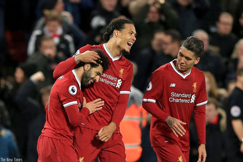 Salah is congratulated by Van Dijk - it was the defender who later fouled Lamela to give away the second penalty. (Net photo)