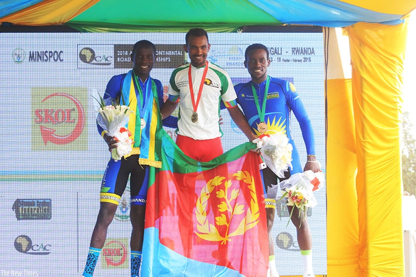 Team Rwanda riders Bosco Nsengimana (L) and Joseph Areruya  (R) pose with Eritrean Mekseb Debesay who won Gold in elite Men's Individual Time Trial yesterday. Sam Ngendahimana.