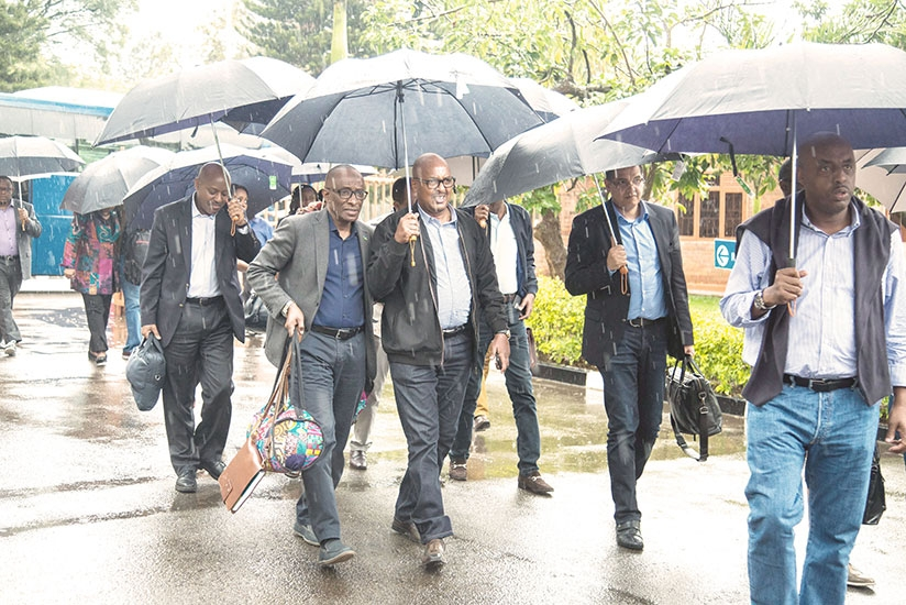 Rwandan ambassadors arrive at the Prime Minister's Office in Kimihurura yesterday ahead of departure to Gabiro for the annual National Leadership Retreat, which opens today. ....