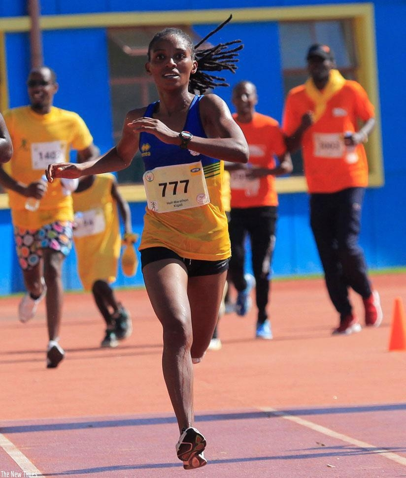 Nyirarukundo crosses the finish line to win last year's Kigali International Peace Half Marathon. (File)