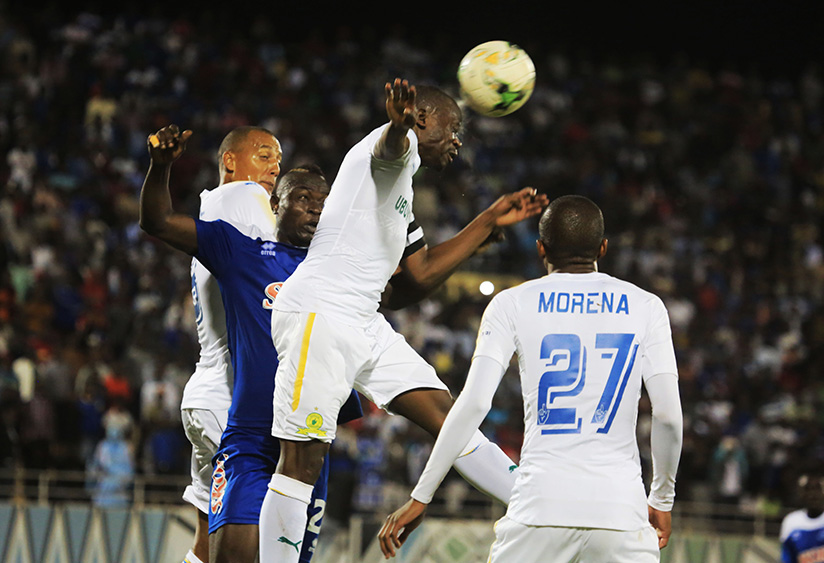 Mamelodi Sundowns skipper Kekana Hlompho in the air vies for the ball  during 0-0 draw at Amahoro National Stadium. / Sam Ngendahimana