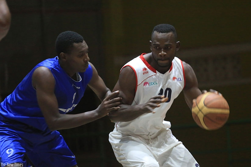 Bienvenue Ngandu (with ball) of REG fends off Regis Gatoto of Espoir during a past league game. Sam Ngendahimana.