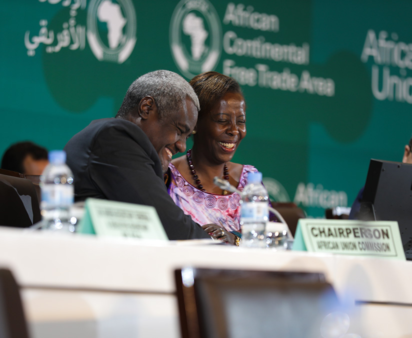 1521500654Chairperson-of-the-Commission-of-the-African-Union,-Moussa-Faki-Mahama-(L)-speaks-to,-Louise-Mushikiwabo,--the-Chairperson-of-the-Council