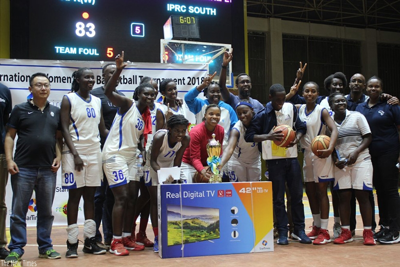 IPRC-South celebrate with the trophy after overcoming APR in the final at Amahoro Indoor Stadium. (R. Bishumba)