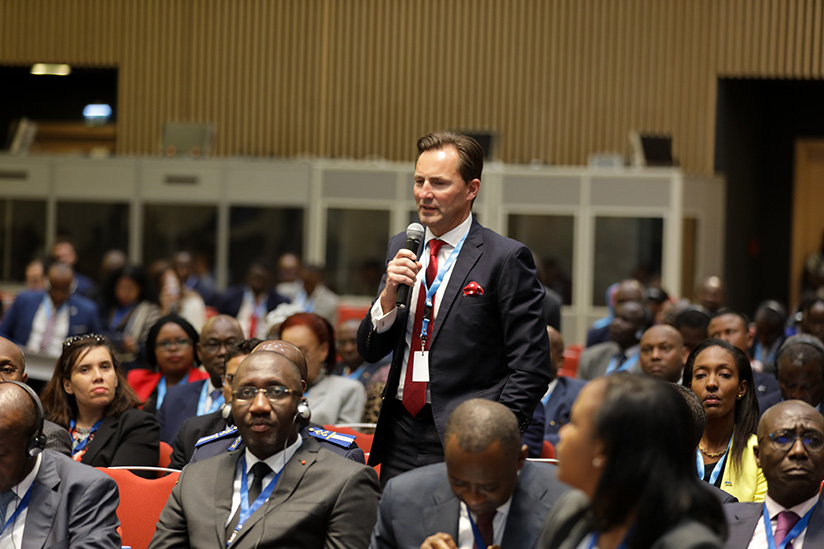 1521615182The-Chairman-and-Chief-Executive-Officer-of-Volkswagen-Group-South-Africa,-Thomas-Schafer-asks-a-question-at-the-summit-in-Kigali