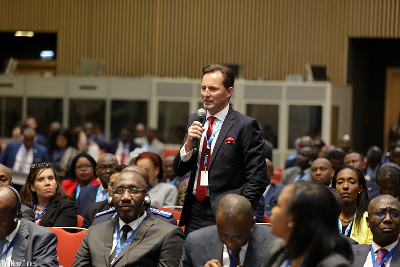 A participant asks a question at the CFTA summit in Kigali. (Timothy Kisambira)