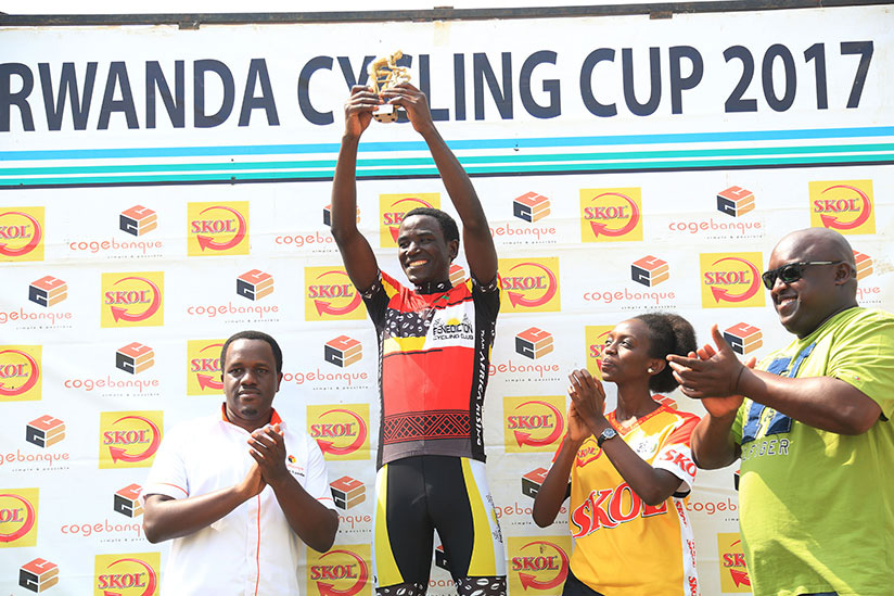 Patrick Byukusenge holds the trophy as the 2017 Rwanda Cycling Cup champion. S. Ngendahimana