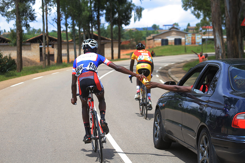 1521922481Nyabihu-cycling-team-assistant-coach-captured-here-gives-water-to-his-rider