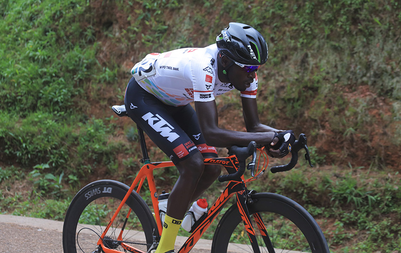 1521922358Les-Amis-Sportif-rider-Valens-Ndayisenga-tries-a-solo-attack-in-Nyanza-District
