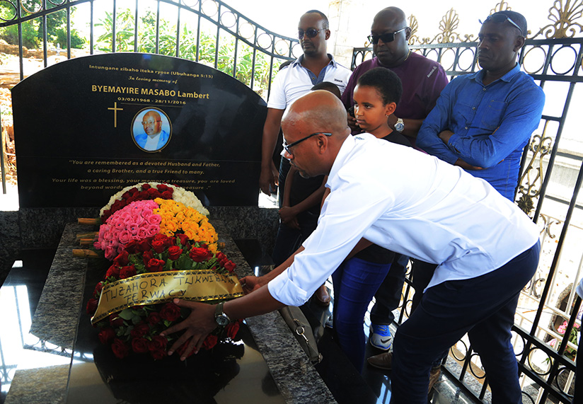 1521922107FERWACY-President-Aimable-Bayingana-lays-wreath-at-former-Rwanda-Cycling-Federation-vice-president-Lambert-Byemayire,-who-passed-away-two-years-ago