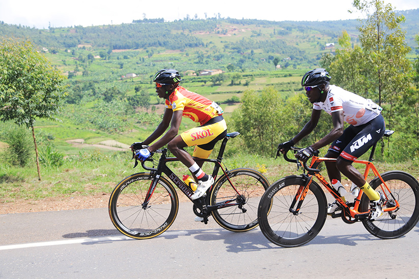 1521923170Tour-du-Rwanda-2015-winner-Jean-Bosco-Nsengimana-and-Two-time-Tour-du-Rwanda-champion-Valens-Ndayisenga-during-the-race