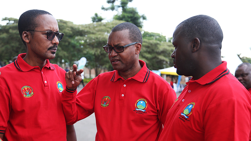 Rutabingwa (L) Busabizwa (C) and Janvier Gasana chat during the closure of Kigali City Councillors' Week at Petit Stadium in Kigali. / Sam Ngendahimana