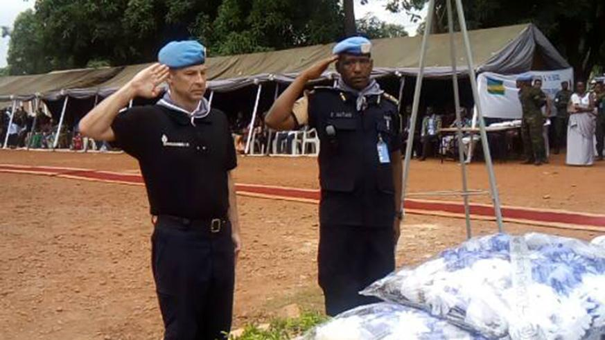 MINUSCA Police Commissioner, Roland Zamora and ACP Emmanuel Hatari, the commander of Rwandan peacekeepers in CAR salute after laying wreath to pay tribute to Genocide victims. / Courtesy