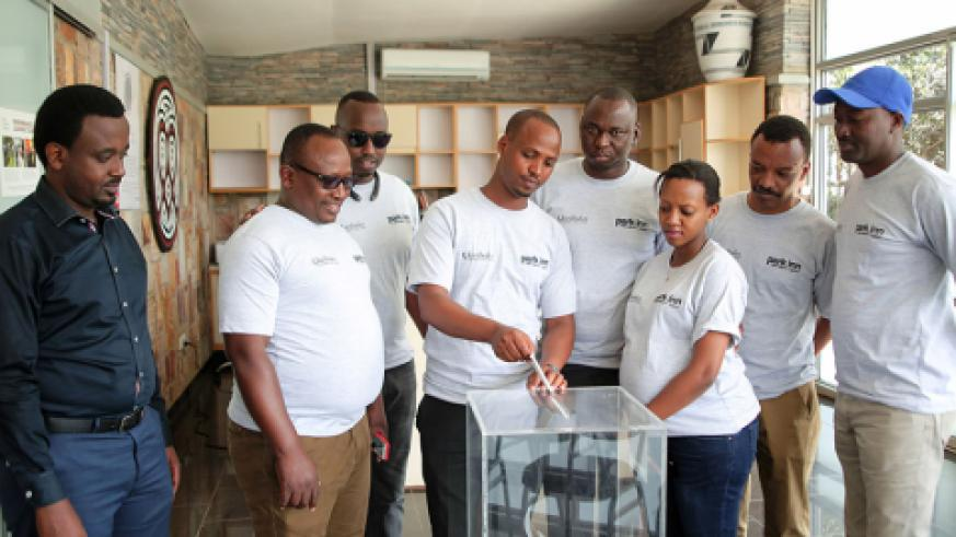 Some of the Park Inn managers donating to Kigali Genocide Memorial.