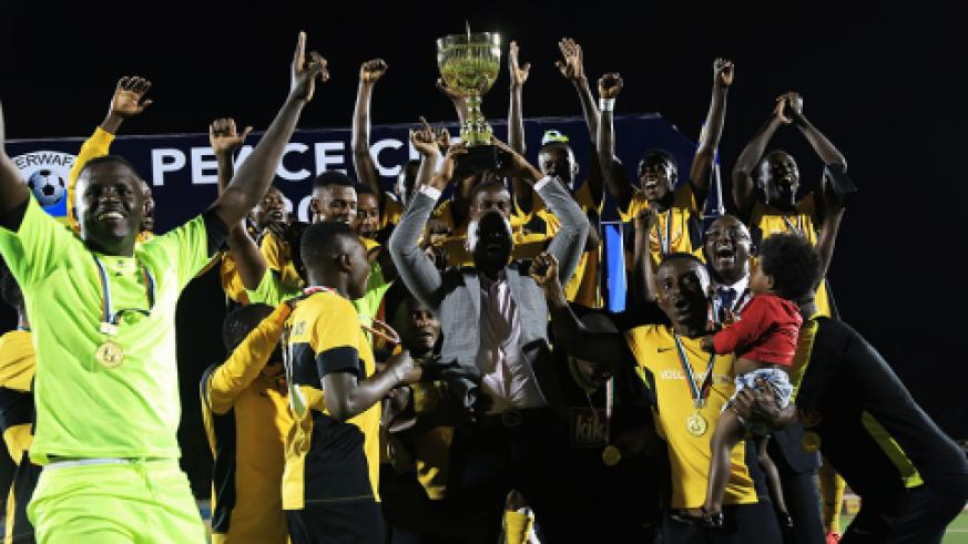 Mukura VS players lift the trophy to celebrate the Peace Cup Champion.