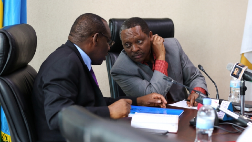 Minister of Local Government Prof Anastase Shyaka consults with Minister of Infrastructure Claver Gatete during a press conference in Kigali yesterday (Sam Ngendahimana)