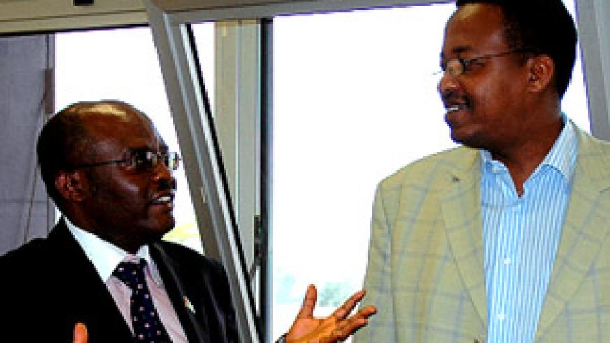 Kenya's Daniel M. Yumbya (L) speaking to Dr Innocent Nyaruhirira yesterday at King Faisal Hospital. (Photo/ G. Barya)