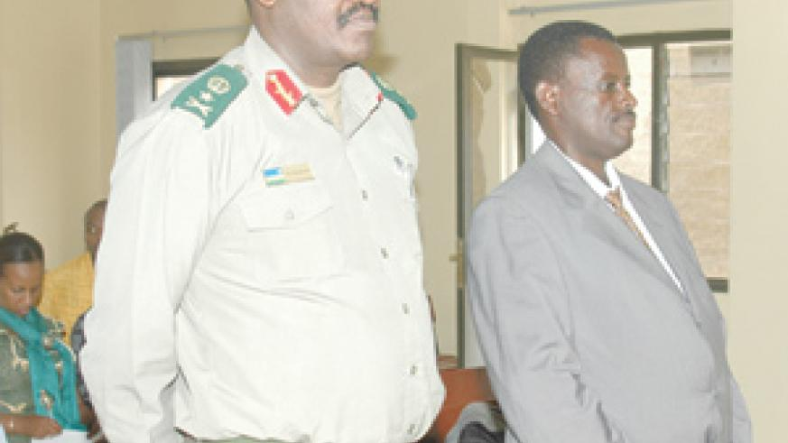 Generals Rusagara (left) and Kaka at the Military Tribunal yesterday. (Photo/G. Barya)