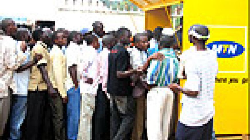 A group of people queue to buy handsets at the MTN stand. This was during a recent Trade Fair in Kigali. (Photo/ E. Nsekanabo)