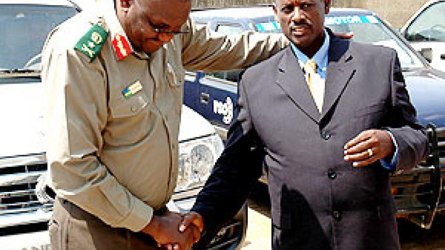 RELIEF: Generals Rusagara (left) and Kaka shortly after their acquittal yesterday