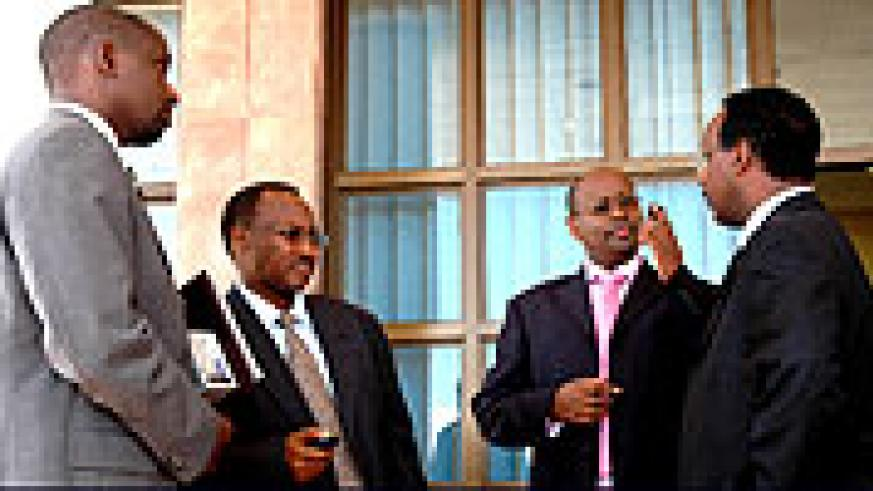 Rwanda Development Bank Director Théogène Turatsinze (L), Protais Musoni, Local Government minister, Finance and Economic Planning minister James Musoni and Eng. Albert Butare, the Energy and Communication state minister at Prime Holdings.(Photo/G. Barya)