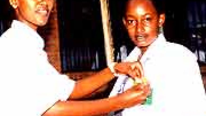 Girls of FAWE Girls School. Girls should not drop out of school due to lack of sanitary towels (File photo)