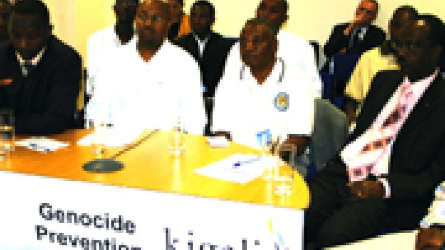 Kaboyi (left) speaking during the teleconference at British Embassy offices in Kigali, while Rutimburana (3rd from left) and other participants have their eyes fixed on the screen. (Photo/G. Muramila)