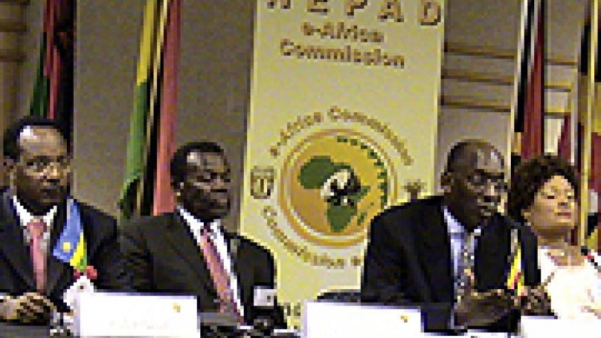 Albert Butare, Rwandan Minister of State for Energy and Communications (L), Dr. Henry Chasia, Executive Deputy Chairperson, NEPAD e-Africa Commission Dr. Ham Mukasa Mulira, Ugandan ICT minister addresses a press conference in Johannesburg and Patricia Kal