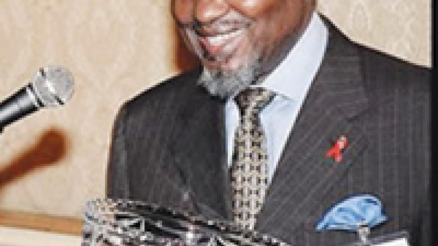 ACHIEVER: Chissano holding the Mo Ibrahim award for his achievements in African Leadership.