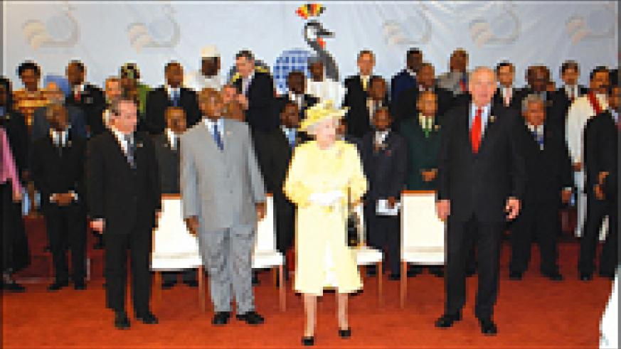Queen Elizabeth II flanked by President Yoweri Museveni (2nd left) at the International Conference Center Kampala to open the Commonwealth Heads of Government Meeting (Courtesy Photo)
