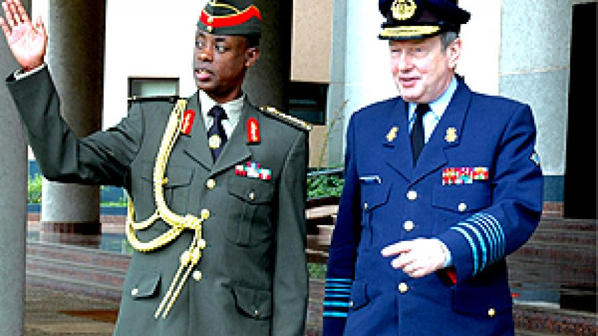 Chief of General Staff General James Kabarebe welcoming the Belgian Chief of Defence General August Van Daele at Ministry of Defence offices yesterday. (Photo/ G.Barya)