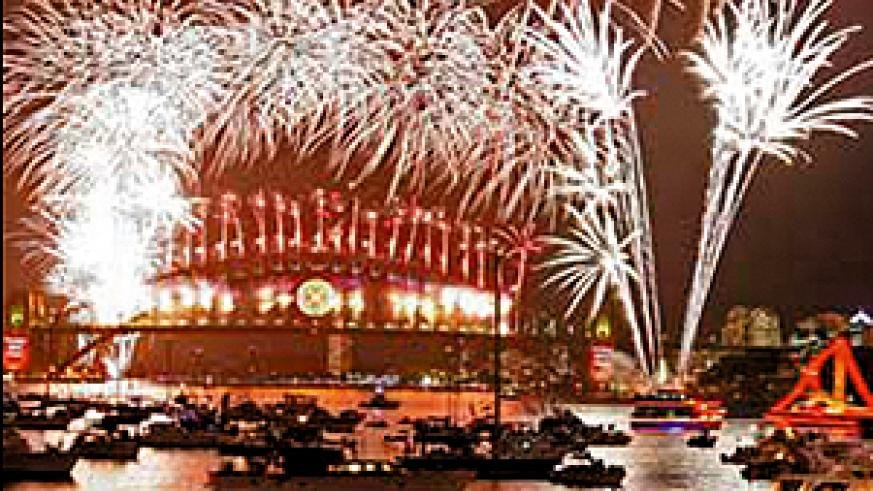 Australians line the foreshore to usher in the New Year with the spectacular 'The Time Of Your Life' firework display over Sydney Harbour.  (AFP Photo)