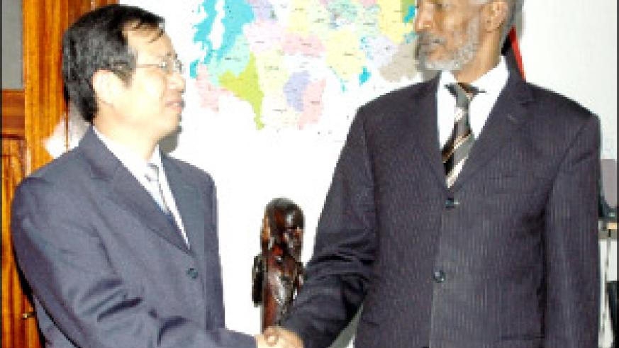 Ambassodor Sun Shuzhon and François Ngarambe at RPF Secretariat offices in Kimihurura yesterday. (Photo / G. Barya)