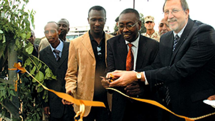 Ambassador Arietti with Secretary General Narcise Musabeyezu cutting the ribbon at the opening of Shyara Primary School (inset) whose construction was funded by the US Department of Defense, European Command. (Photo/G. Barya)